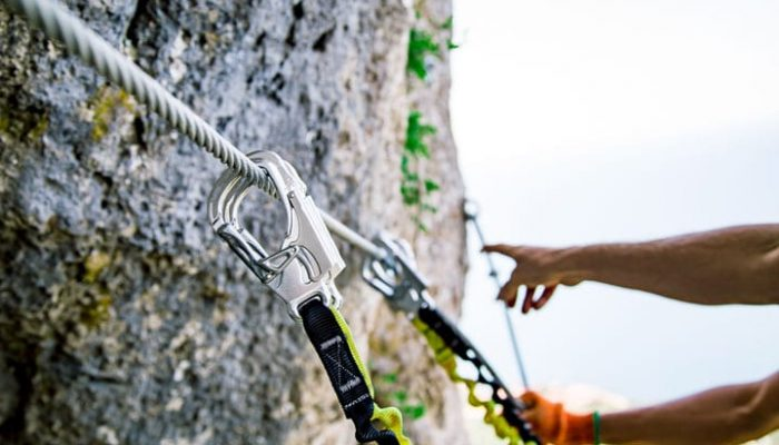 Guide shows ropes on via ferrata