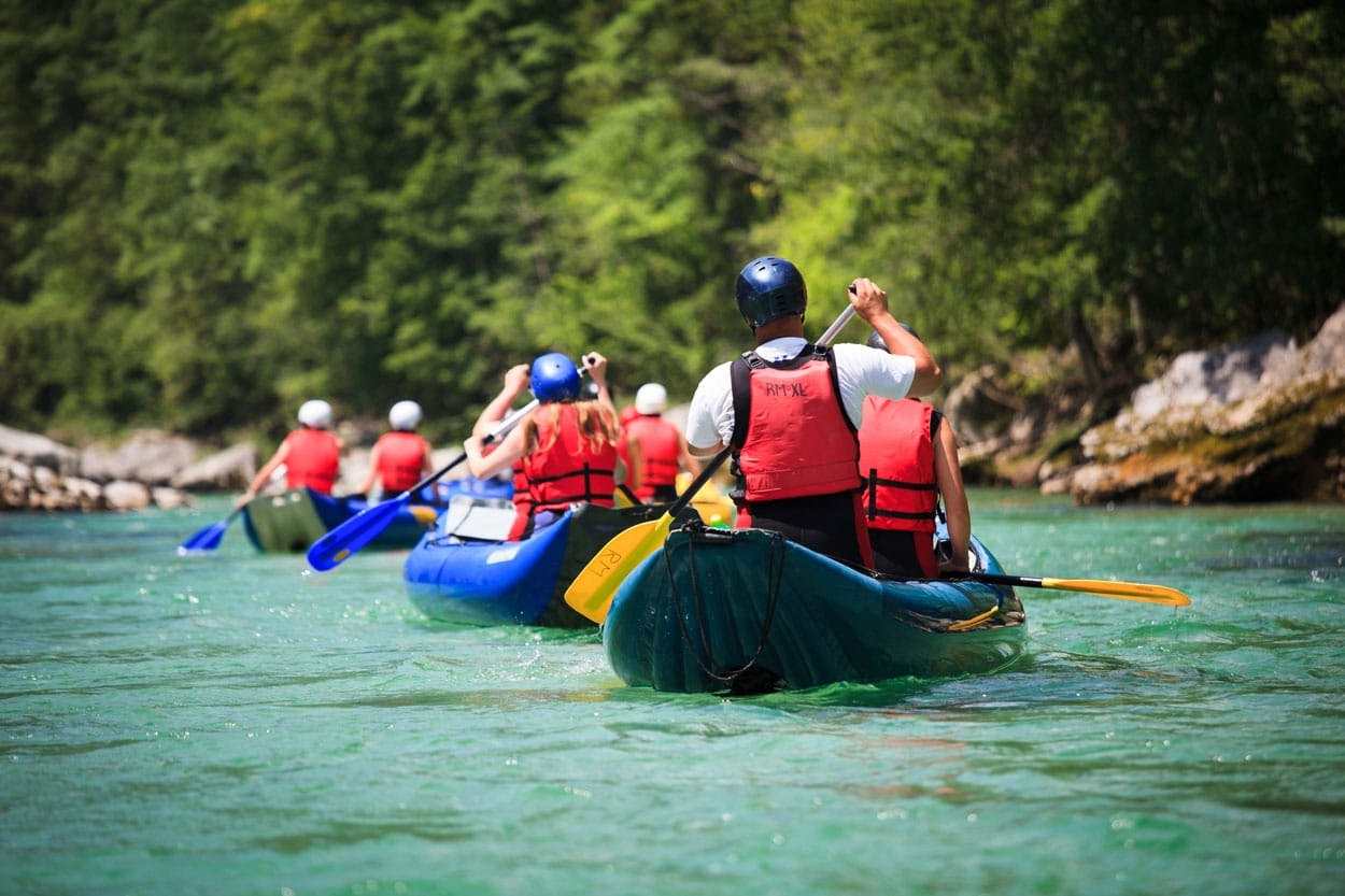 Group of friends rafting in Bohinj