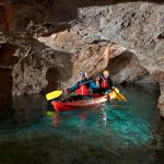 Couple experiencing cave kayaking