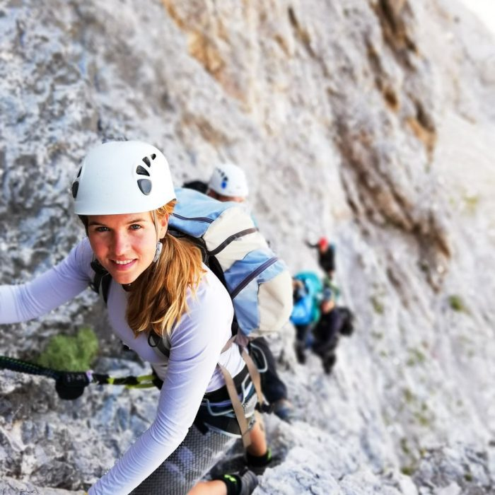 Girl in front of the group climbing Triglav