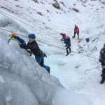 People on the start of an ice climb
