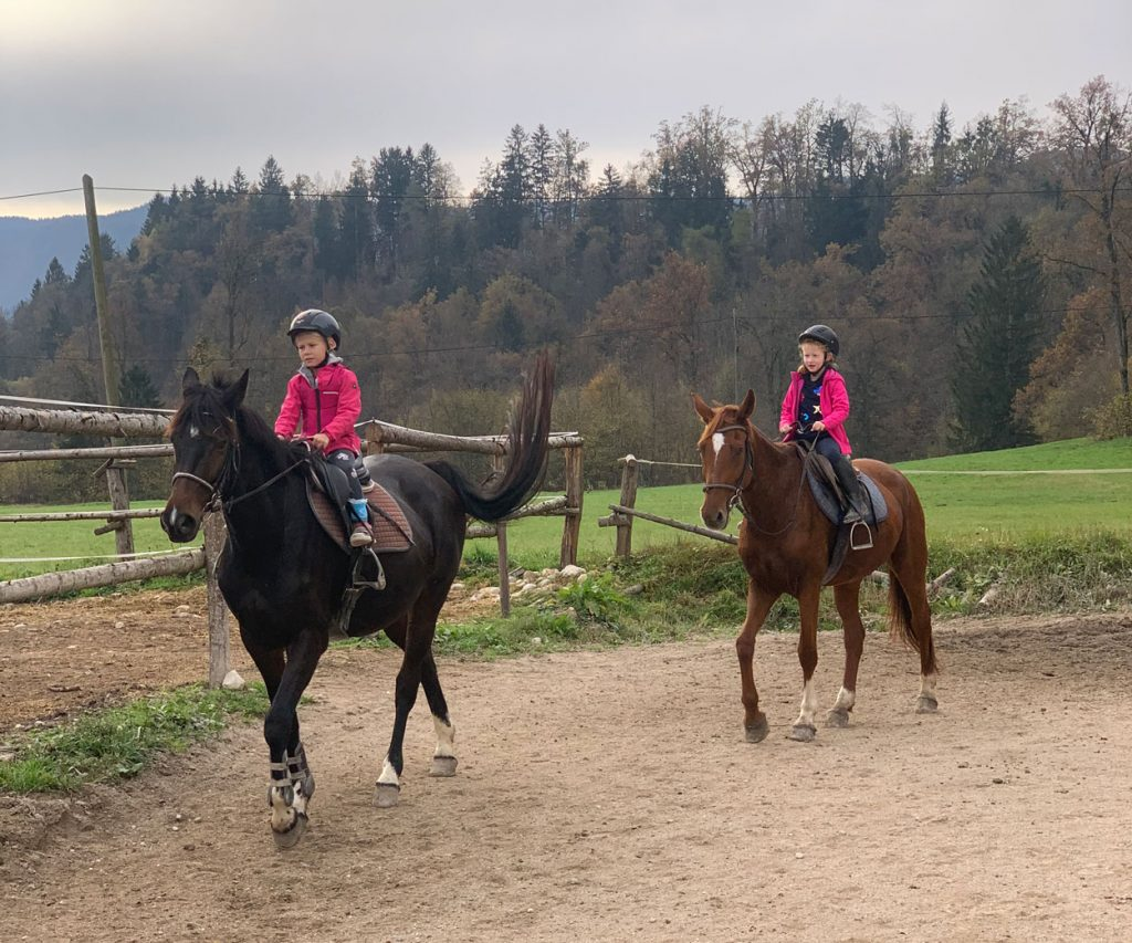Children riding horse near Lake Bled