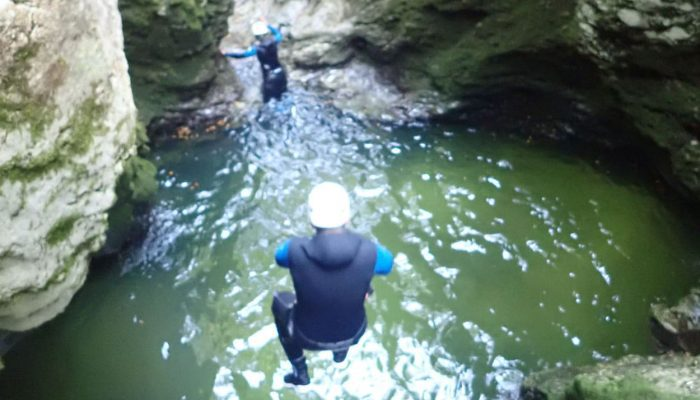 Jumping in the water during canyoning adventure