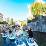 Girls stand-up paddle boarding in Ljubljana