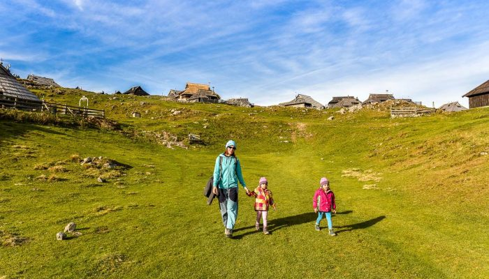 Walking around with kids in Velika Planina