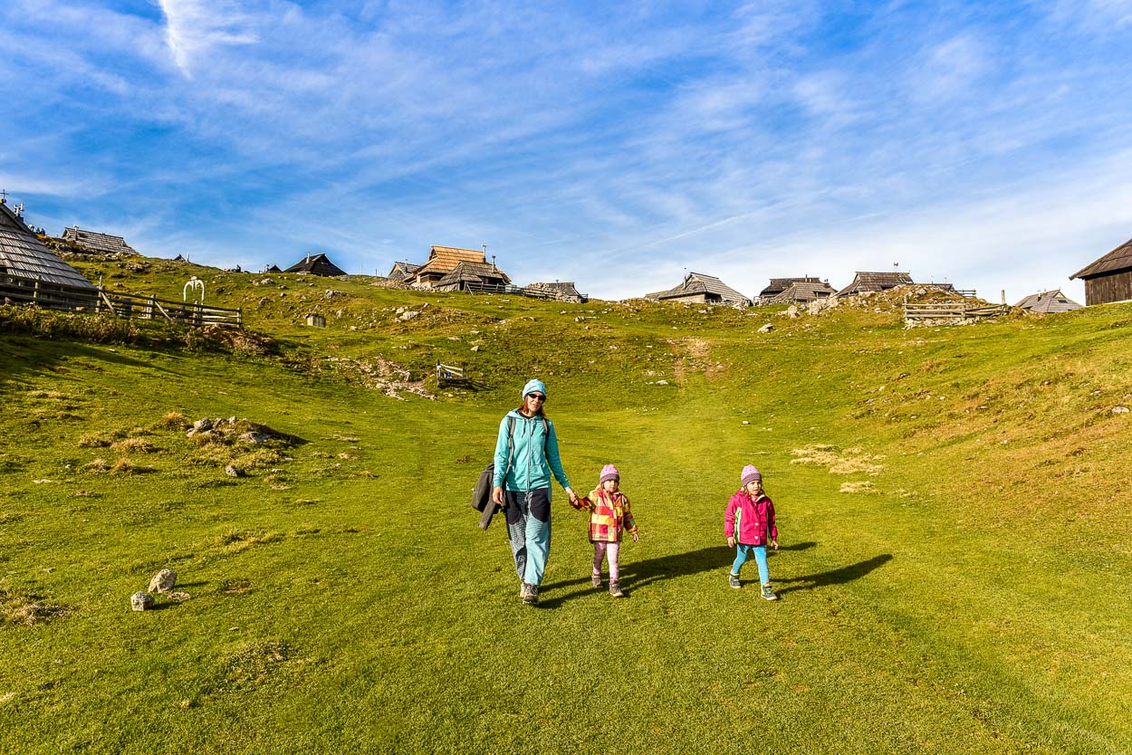 Mother with children at Velika Planina