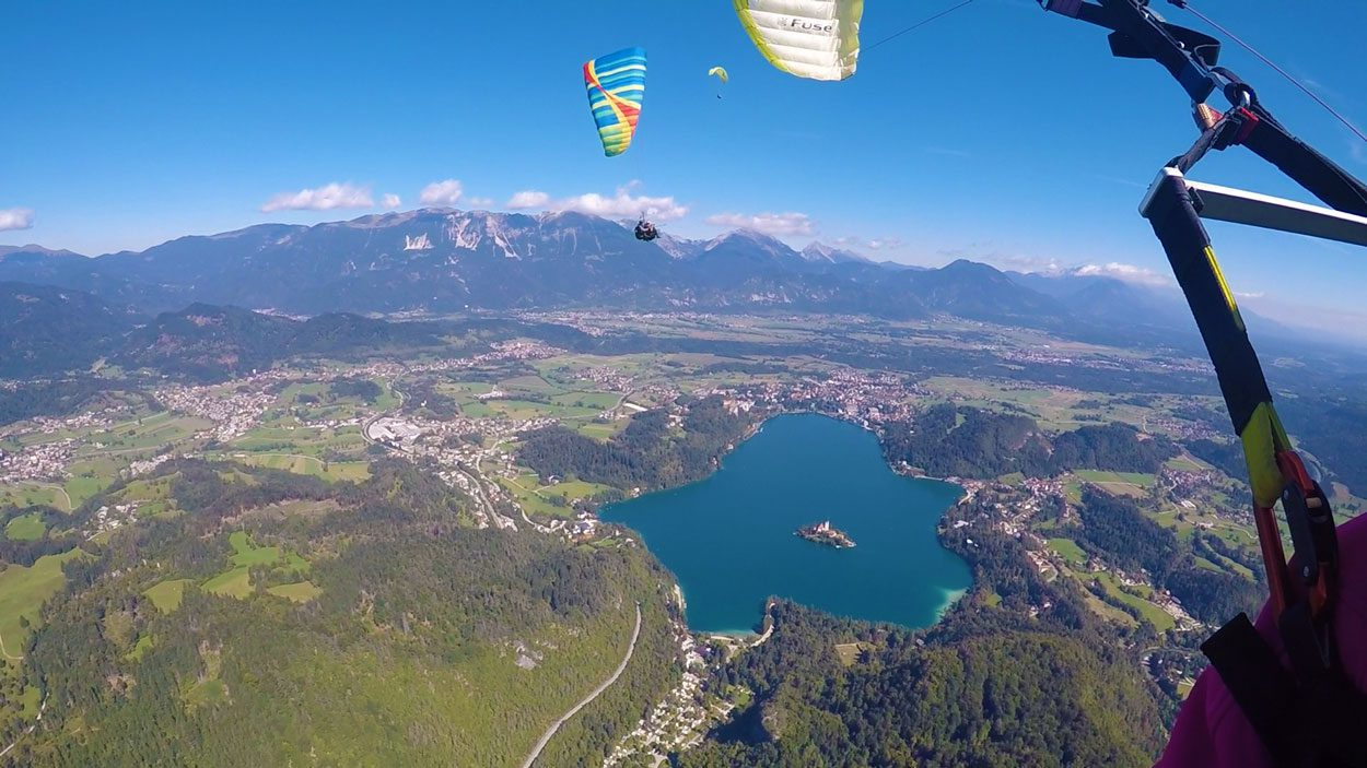 A view while paragliding over Lake Bled from above
