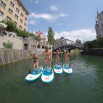 Group of women Ljubljana stand-up paddling