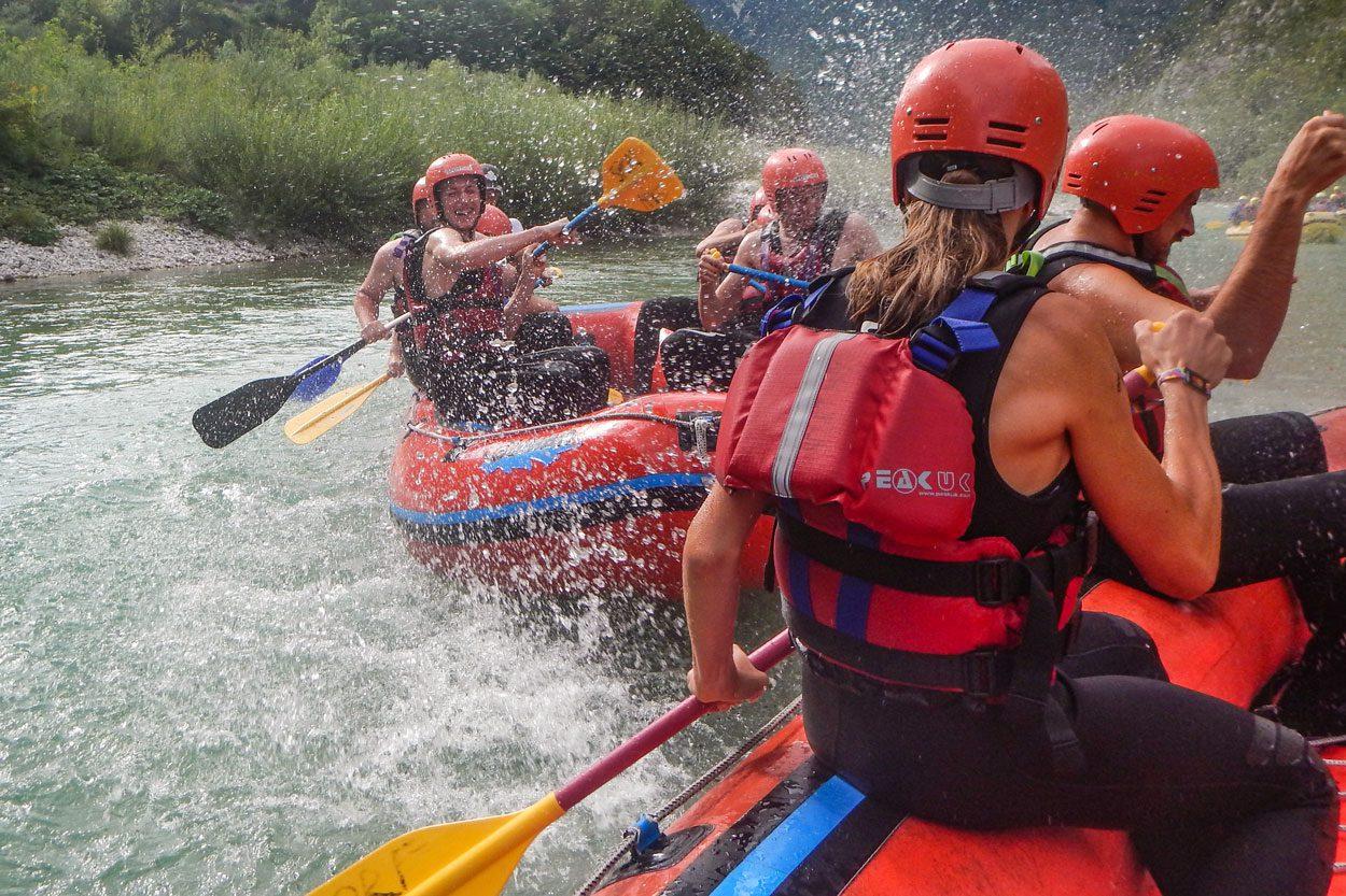 Two groups having fun rafting