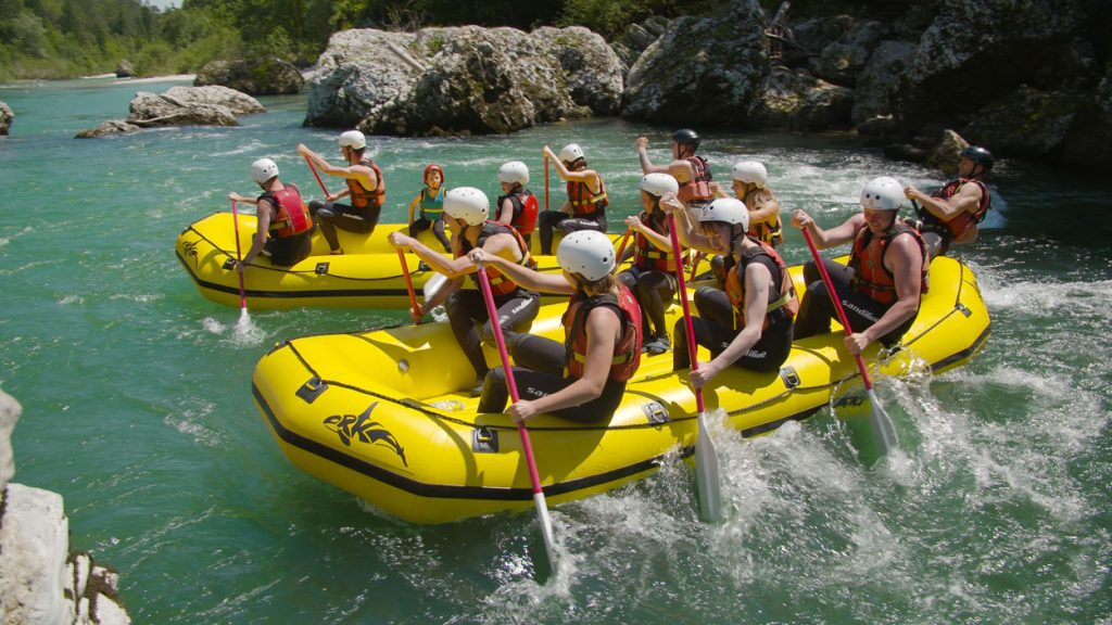 Spending hot summer day rafting on Soča river