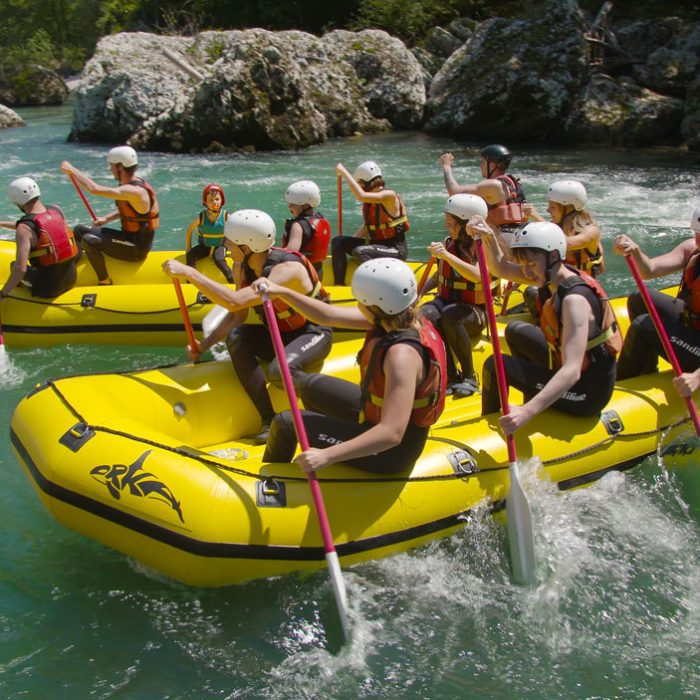 Two groups rafting together in summer