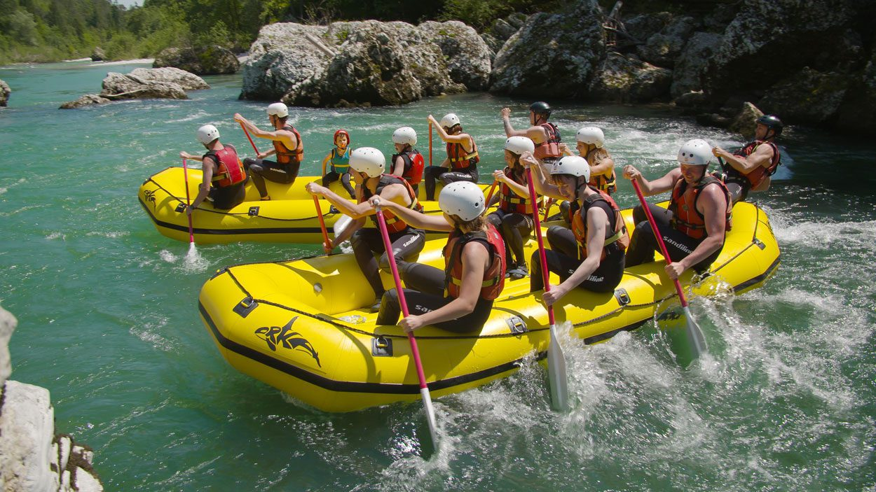 Spending hot summer day rafting on Soča river