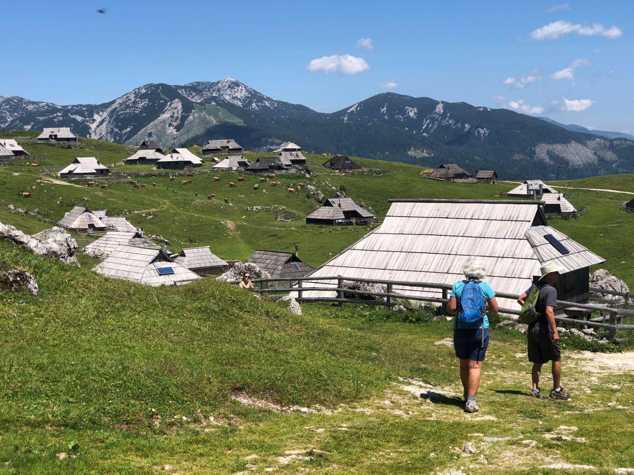 Two hikers on Velika Planina huts area