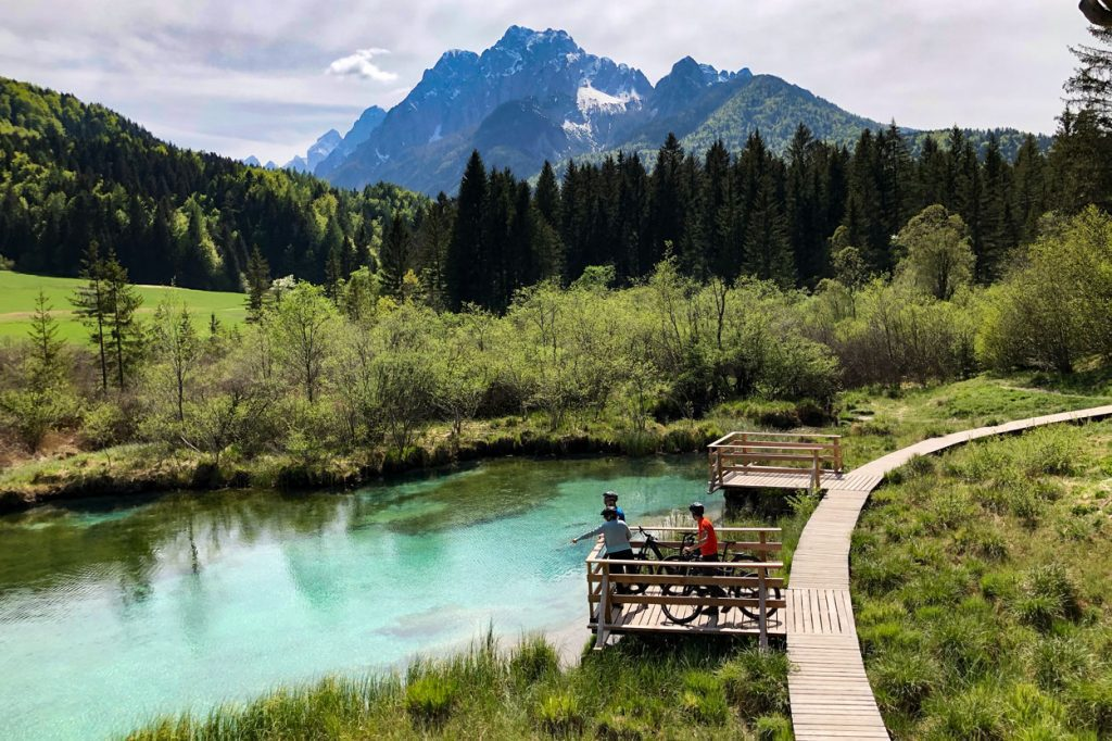 Group of cyclists enjoying the Zelenci spring