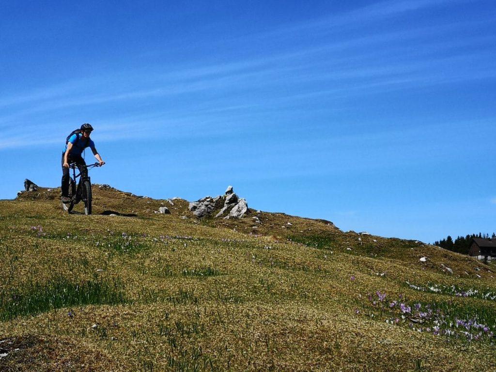 Biking on grass on Velika Planina