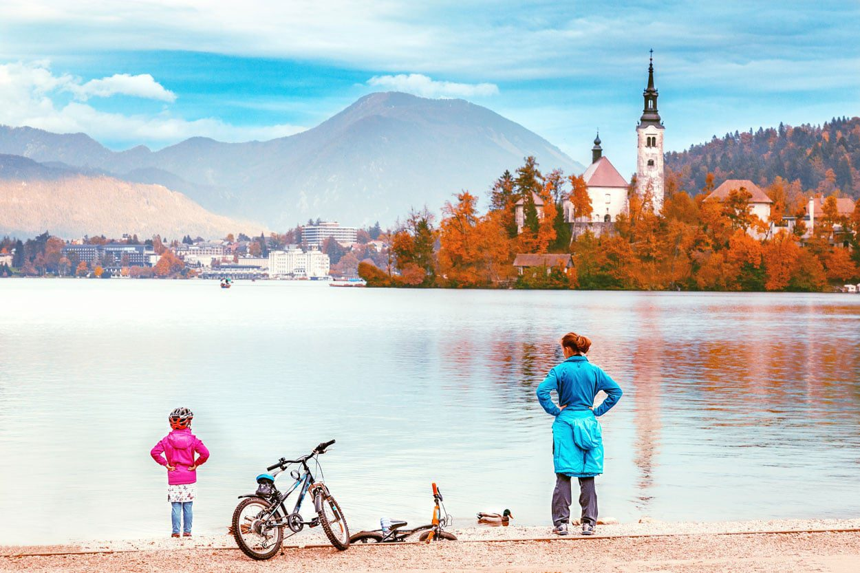 Family cycling around the lake in Bled