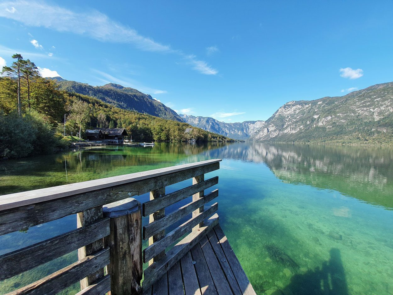 Crystal clear lake in Bohinj on a sunny day