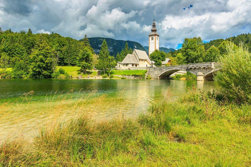 Church overlooking lake Bohinj