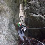 A group of people canyoning