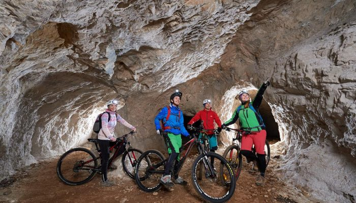 Exploring underground world with cave cycling