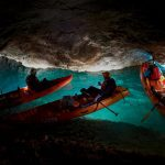 Traffic jam on the water road through the cave