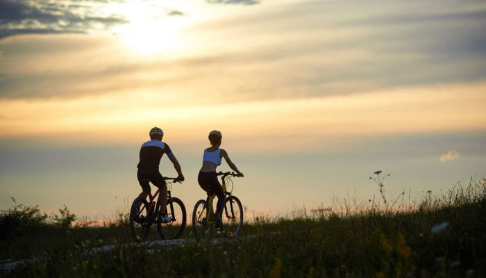 Cycling in the evening and admiring sunset