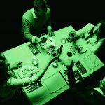 Group of people having dinner in the dark