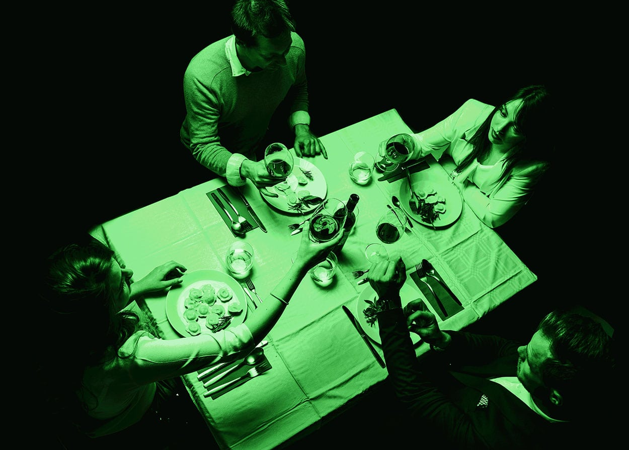Group of people having dinner in the dark
