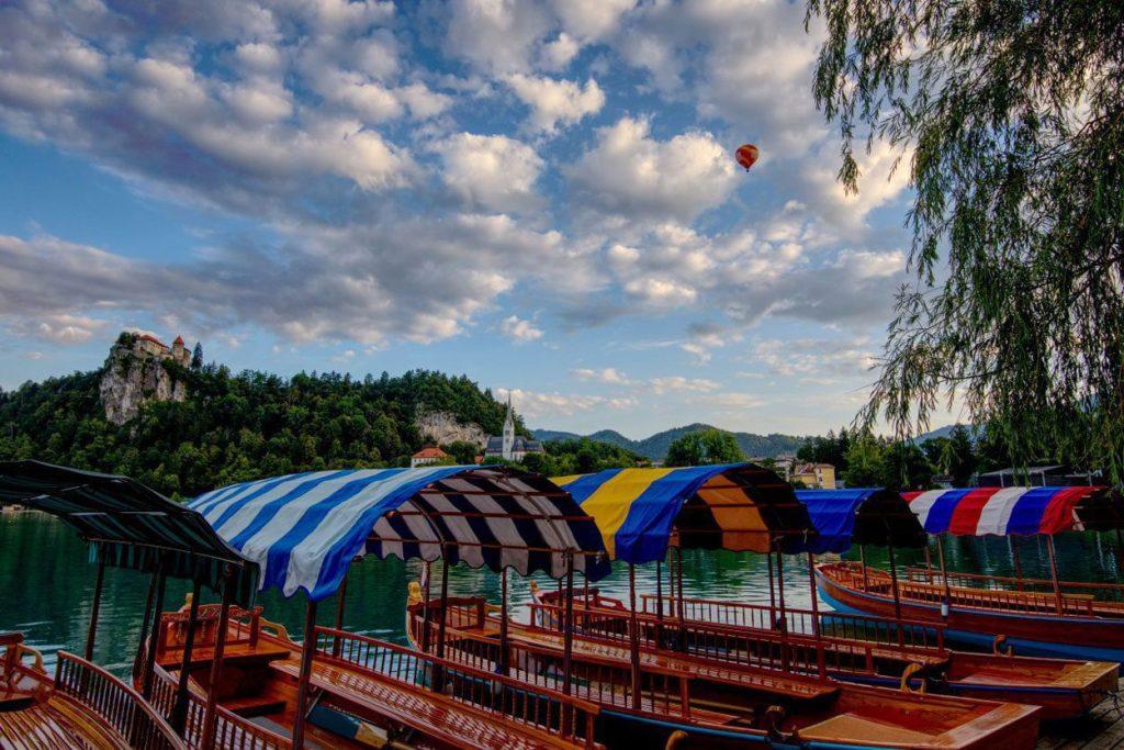 Hot air balloon flight over pletna boats in Bled