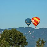 Hot Air Ballons flying over mountains in Slovenia