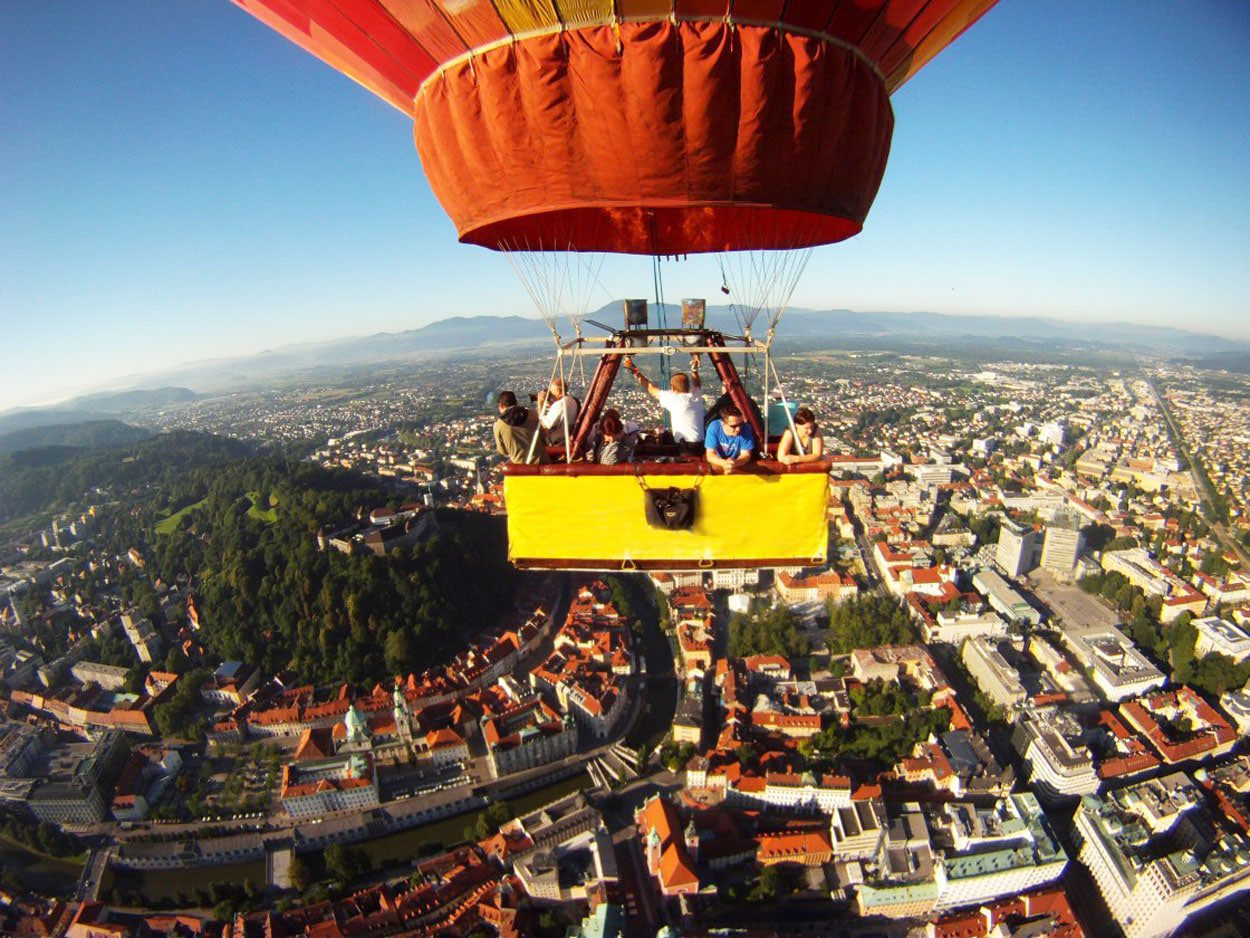 Group of people in a hot air balloon over Ljubljana
