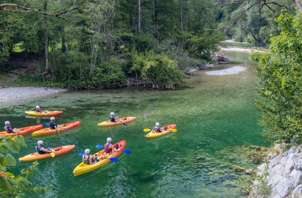 Group of people in kayaking down the river