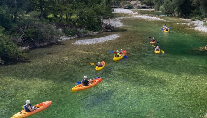 Group kayaking in a river