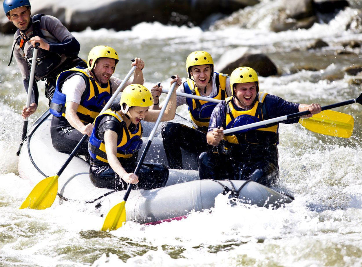 A group of people rafting and having a lot of fun