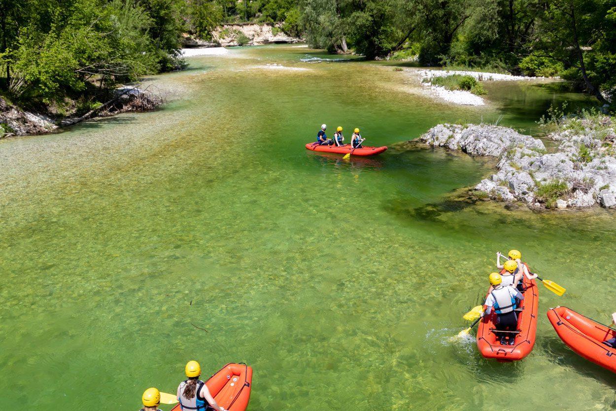 4 groups of people rafting in Bohinj
