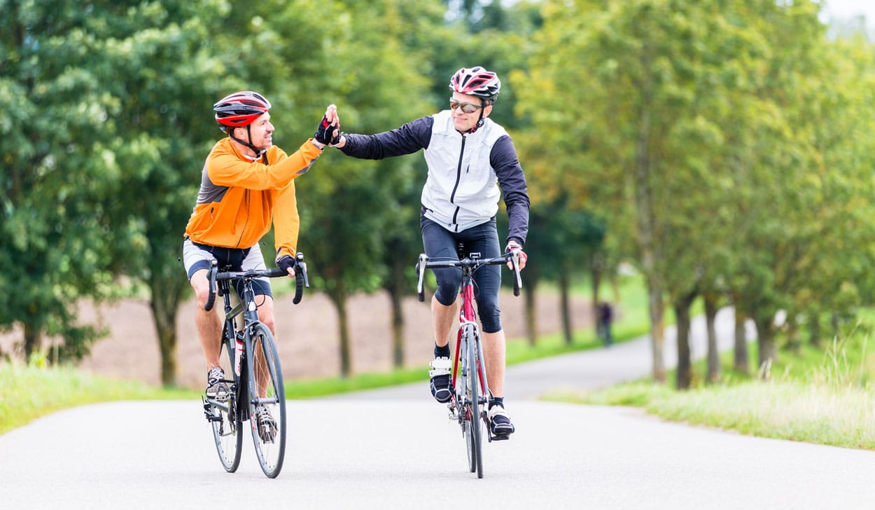 High five after a good road cycling