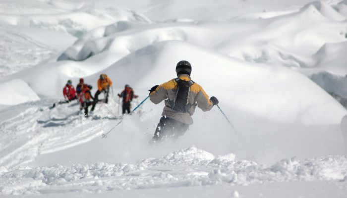 A group of ski tourers skiing in Slovenian mountains