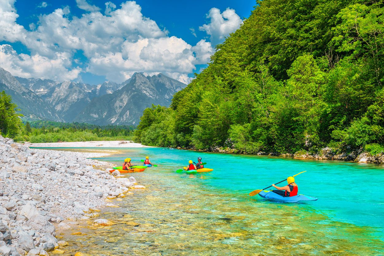 Kayaking on Soča will surprise you with beautiful views