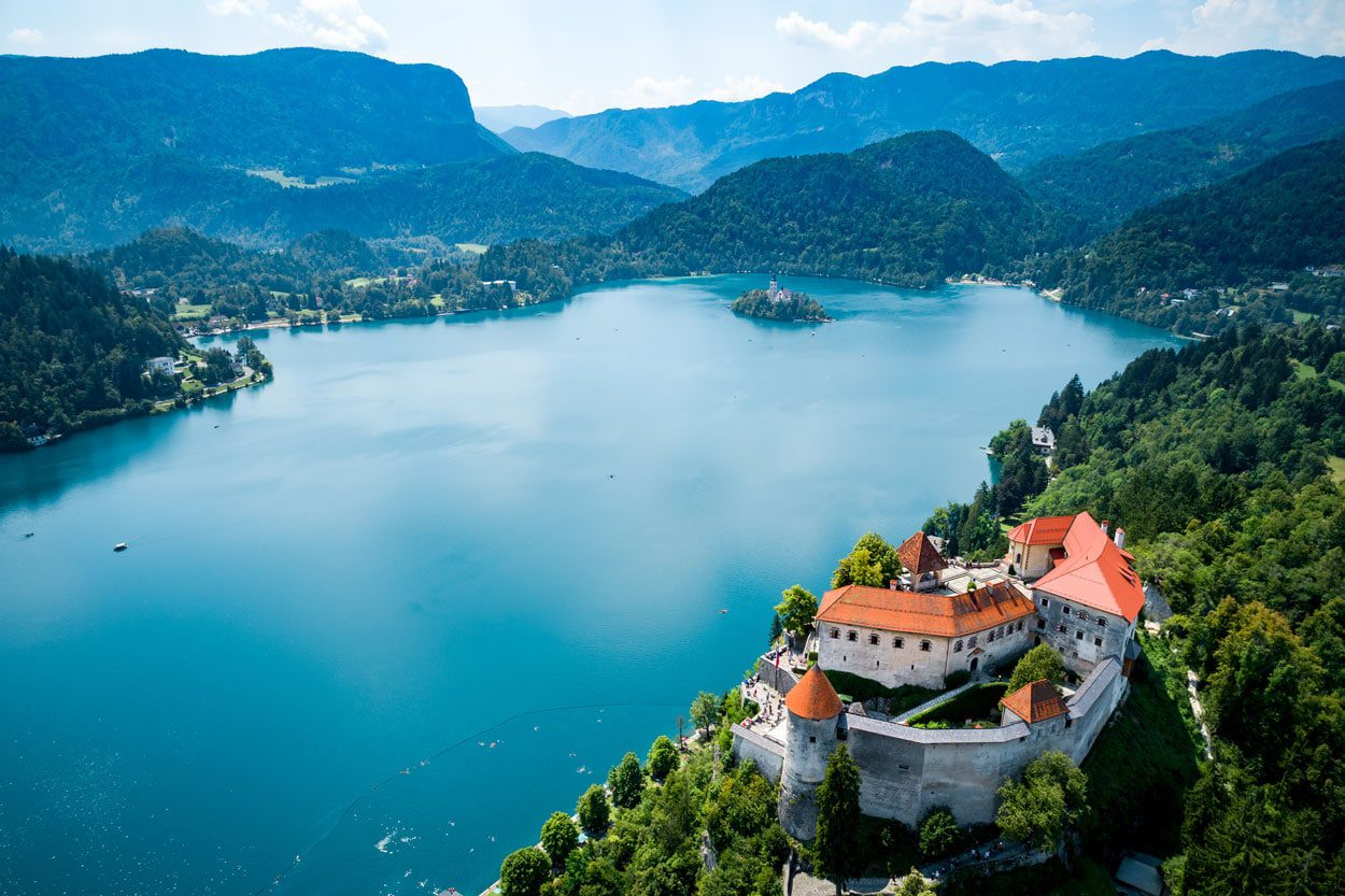 Lake Bled with a small island and beautiful castle on the rock